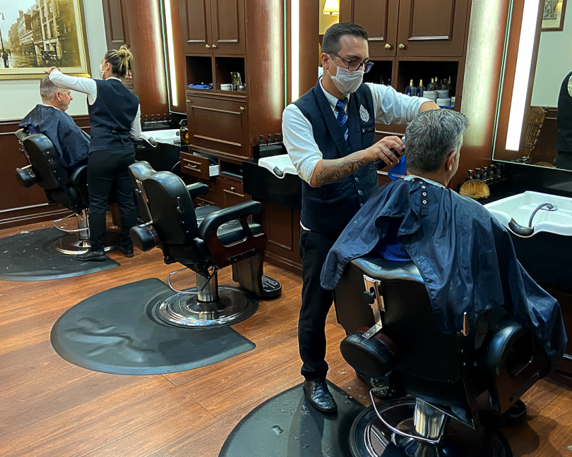 Barbers take additional precautions to prevent the spread of the COVID-19 virus during their work at Truefitt and Hill in Civic.