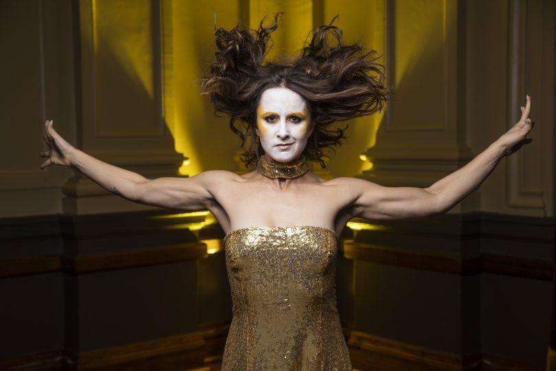 Eliza Sanders wrapped in gold