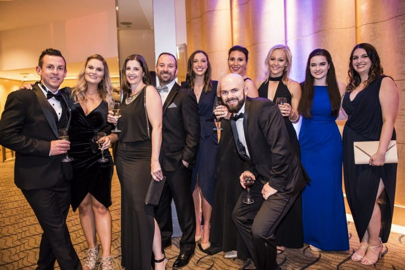 Lara Morgan (second from left) and the Allinsure team posing at a formal event.