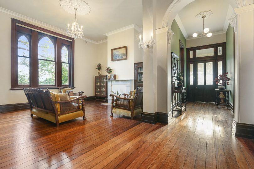 Polished hardwood floors, chandeliers and high ceilings