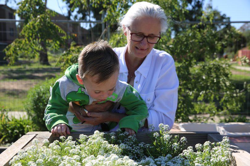 Trish and boy in garden