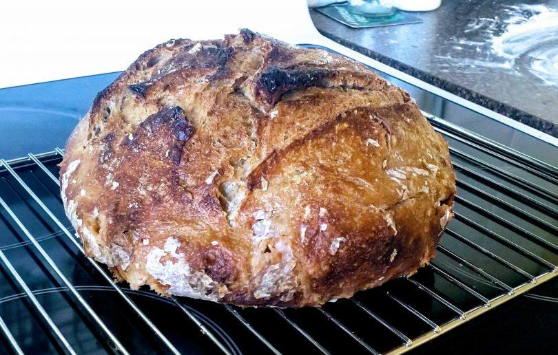Freshly-baked loaf of sourdough bread