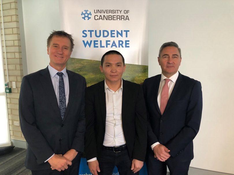 UC student Muhammad Yasin Hamraz (centre) with Professor Pratchett (r)