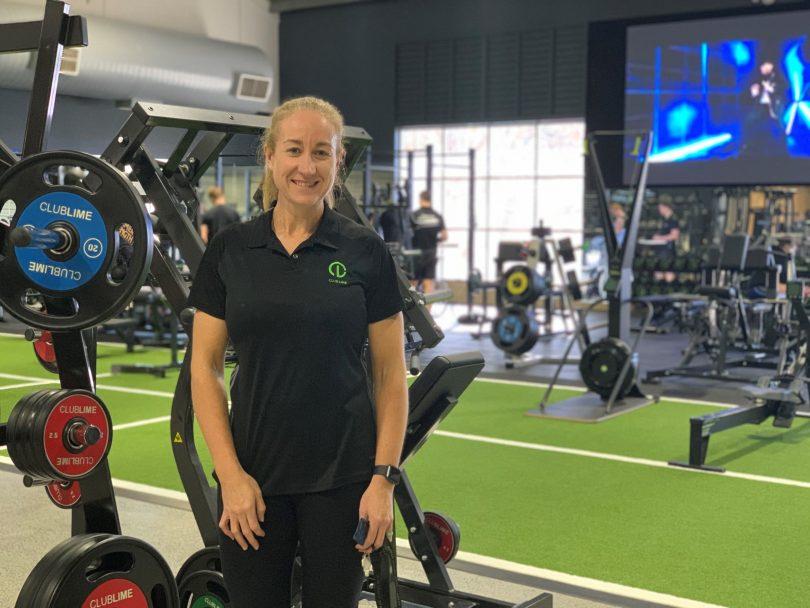 Emma Stockbridge standing in Club Lime gym.
