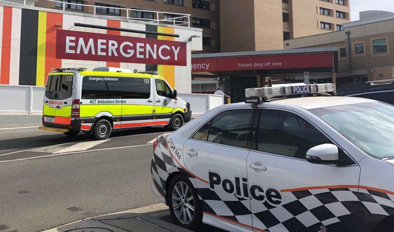 Ambulance and police car outside Canberra Hospital.