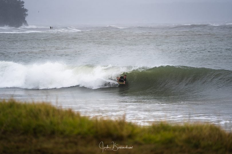 A surfer getting barrelled at Casey's Beach at Batehaven.