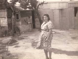 Historic photo of Dixie Byrne (nee Brown) standing outside her house at Oak Hill in Yass
