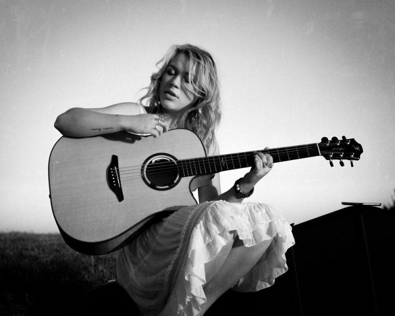 Canberra singer/songwriter Vendulka with guitar.