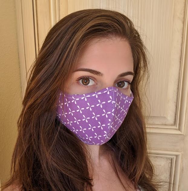 Woman wearing homemade face mask.