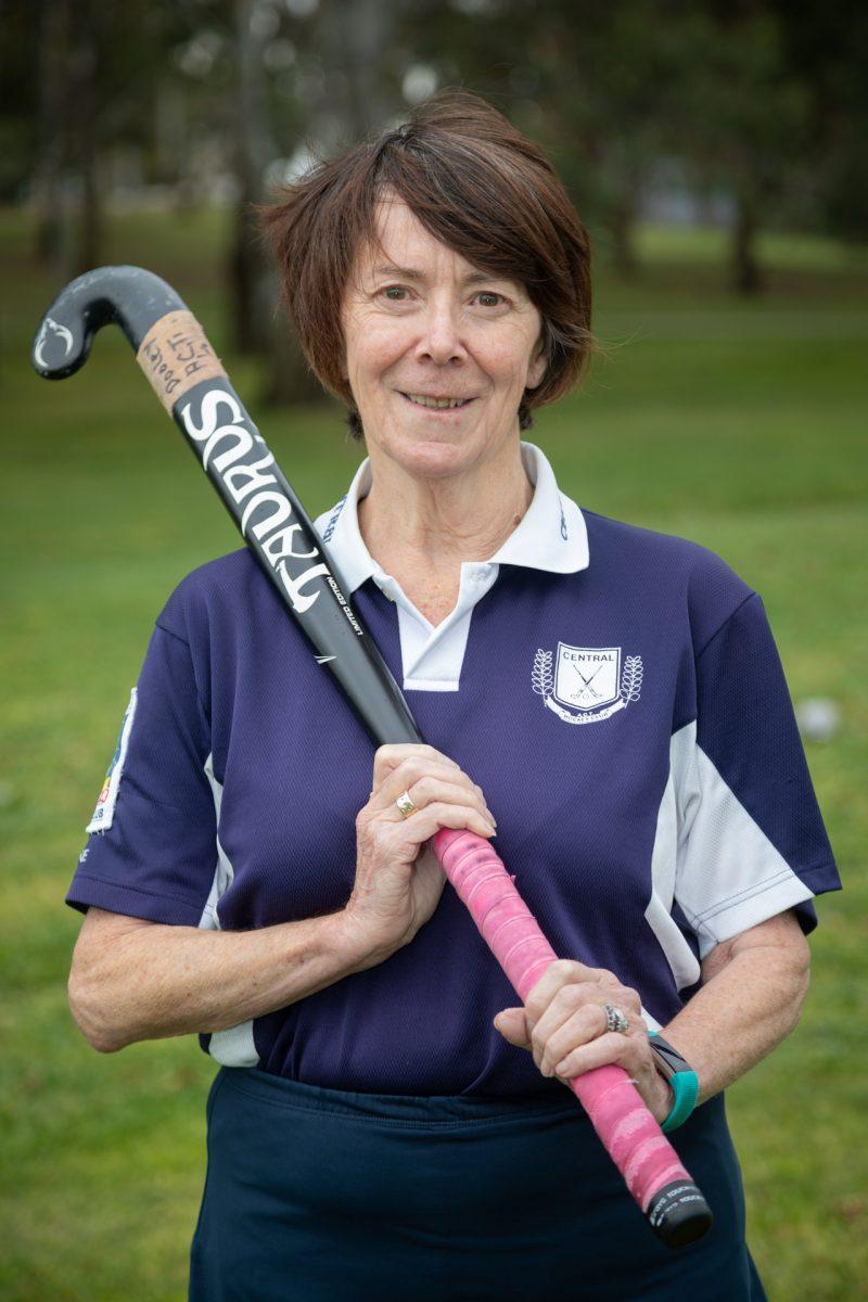 Catherine Dooley holding hockey stick.