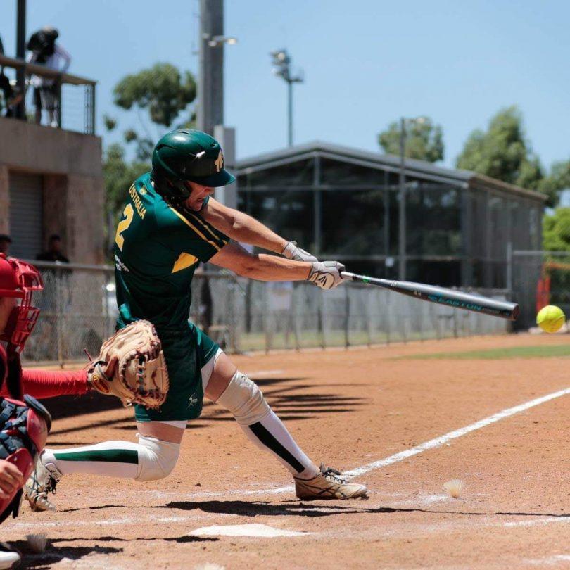 Clare Warwick playing softball.