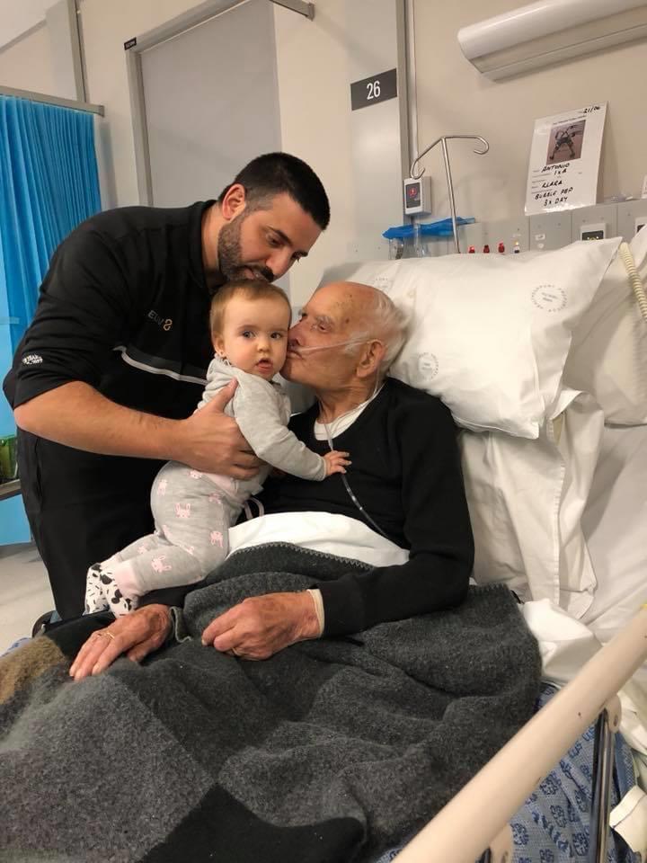 Michael Caggiano with his baby daughter and Antonio Fischetti