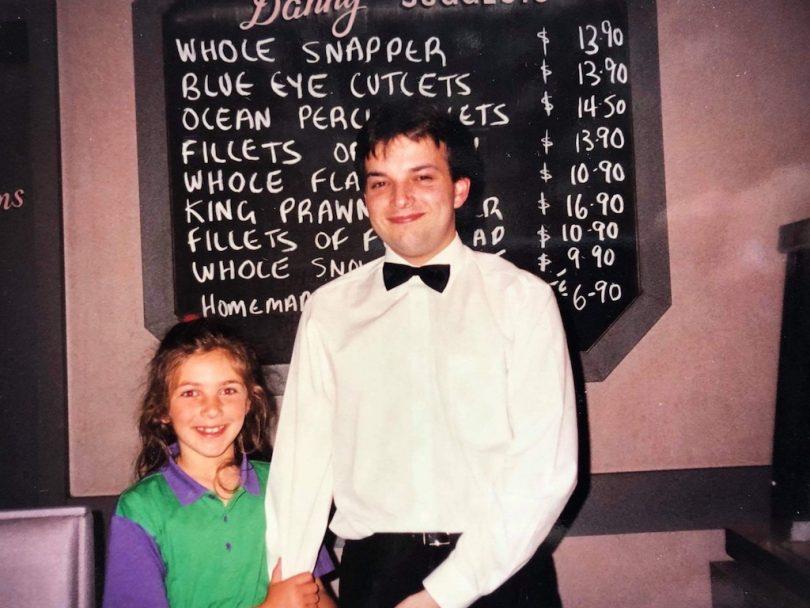 Phillip Stamatellis with cousin Katerina Hrisostoumou in restaurant.