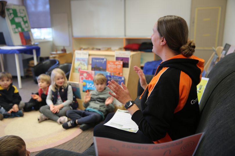 Communities@Work educator teaching class of children.