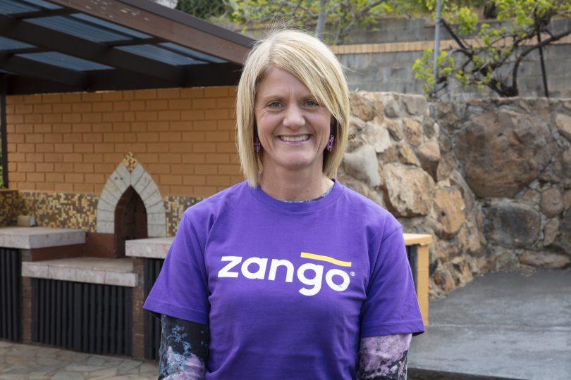 Home.byHolly principal Holly Komorowski wearing purple Zango shirt.