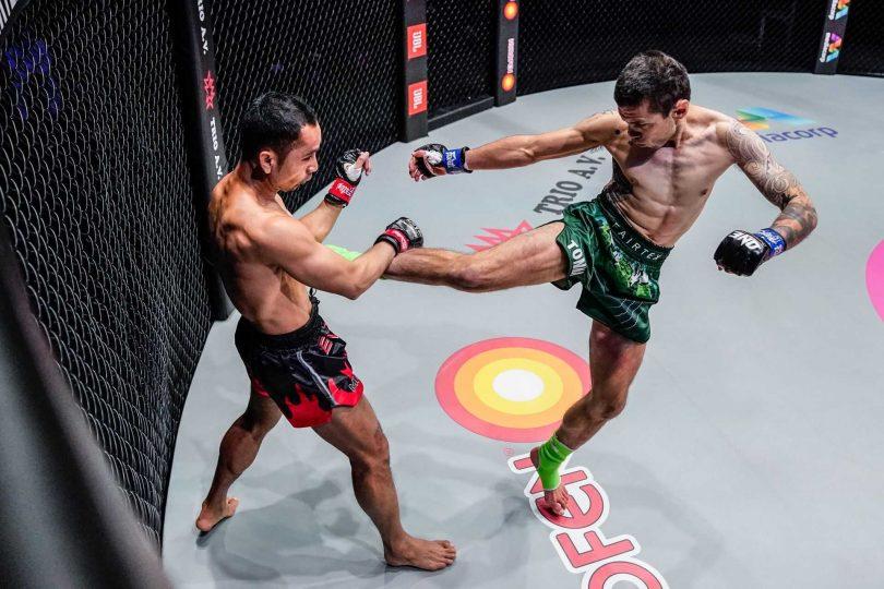 Josh Tonna lands a kick on Sam-A