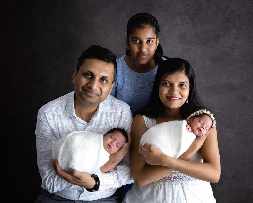 Namita Mittal and Tarun Jain with their twin babies and eldest daughter.