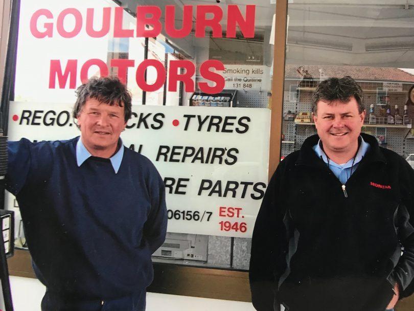 Chris and Steve Parlett standing in front of mechanic's window.