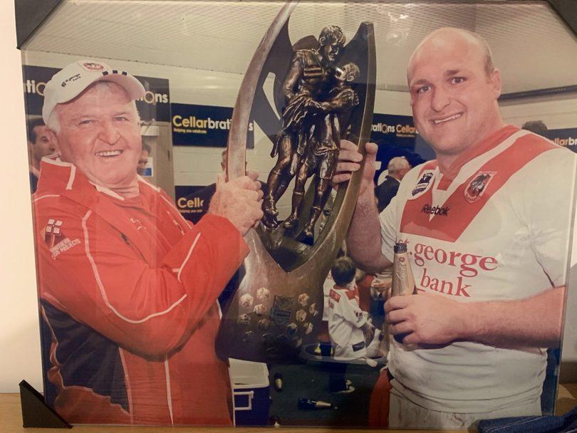 Ack and Mick Weyman holding NRL Premiership trophy.