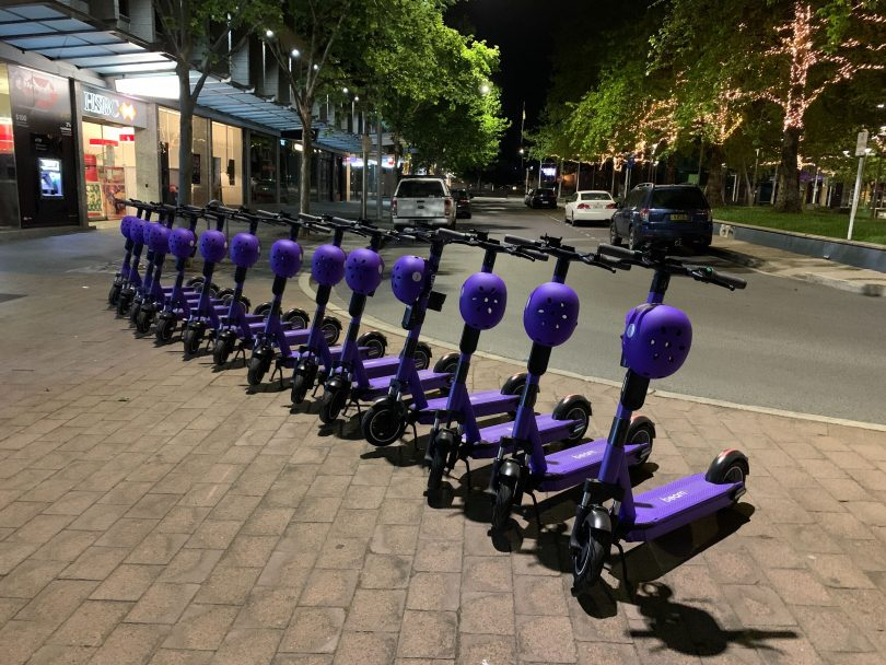 Beam e-scooters lined up in Civic.