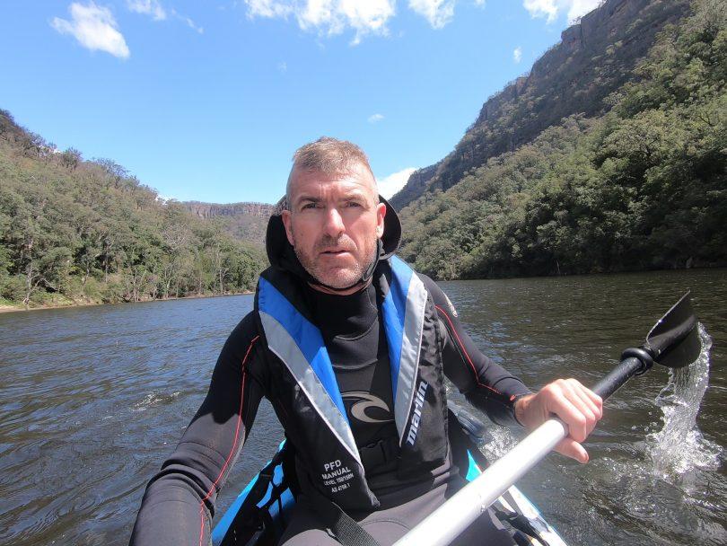 Andrew Oberg kayaking on Shoalhaven River.