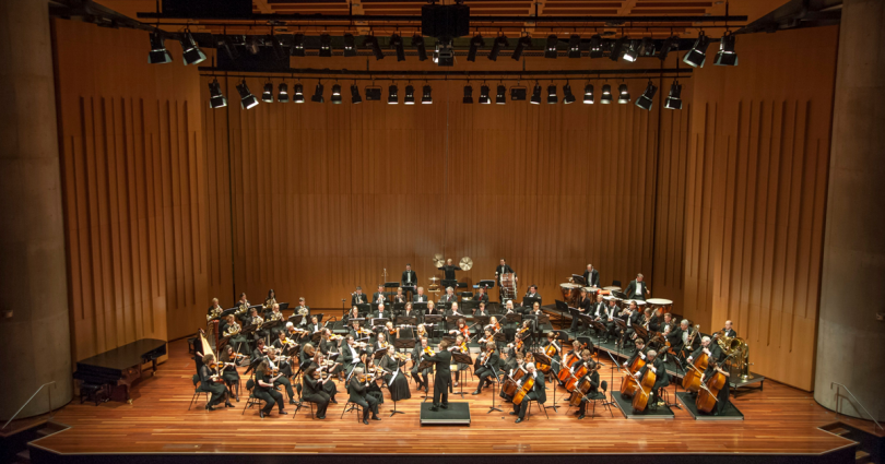 Canberra Symphony Orchestra performing onstage.