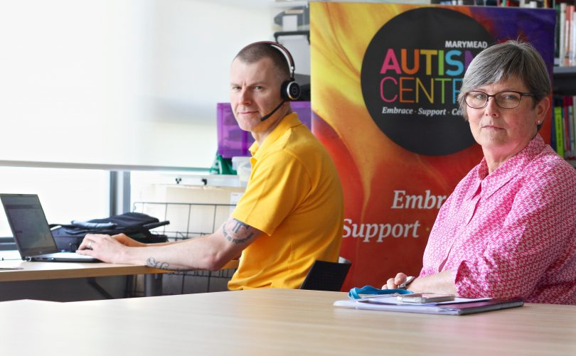 Adam King and Helen Gardner at Marymead's autism call centre at Narrabundah.