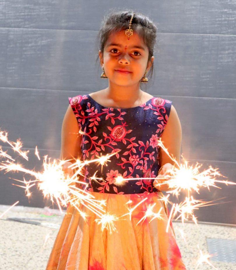 Indian girl holding sparklers