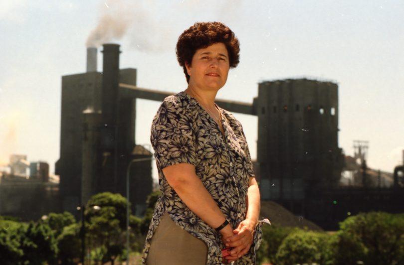 Mara Goluza standing in front of steelworks.