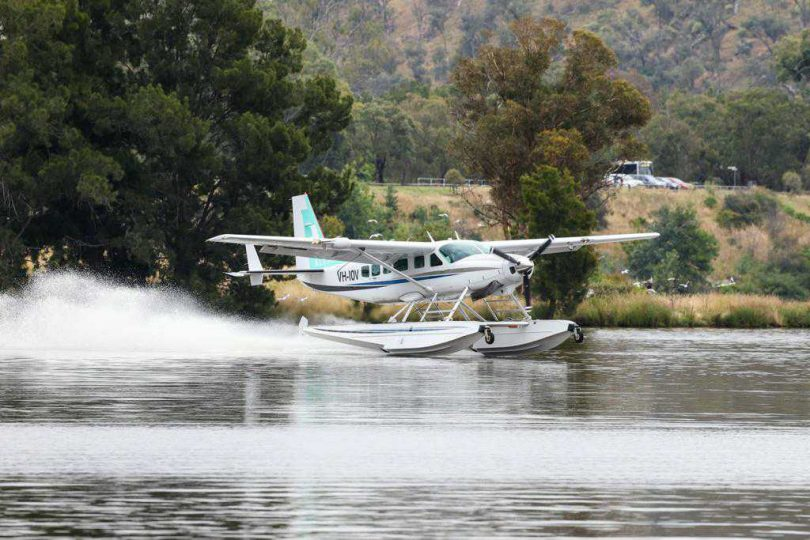 Seaplane touching down on Lake Burley Griffin