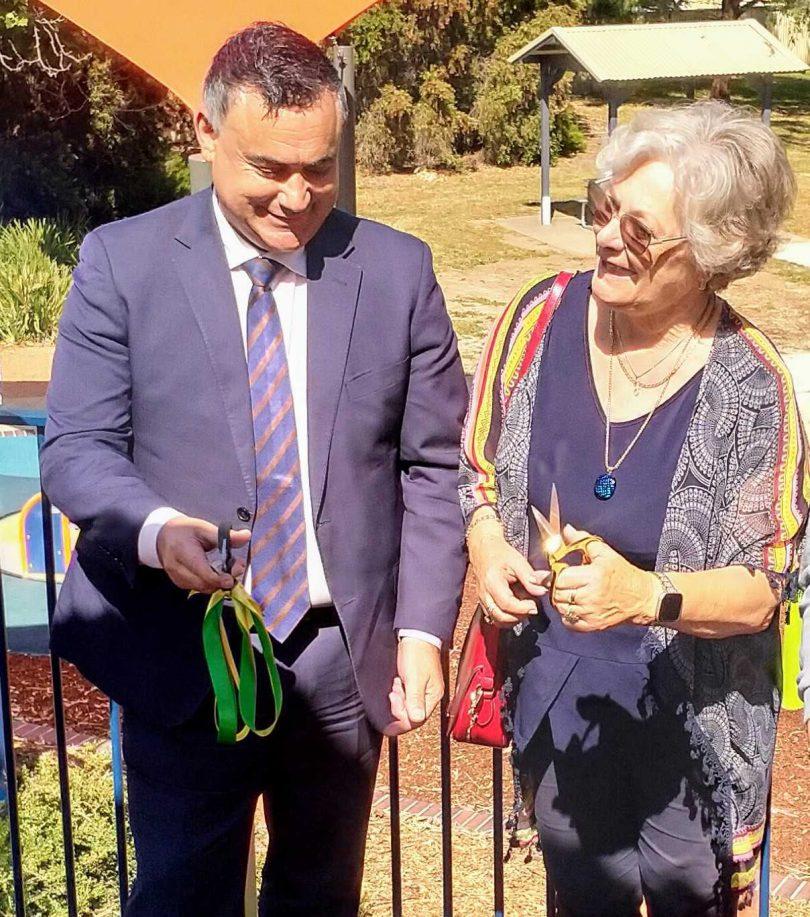 Member for Monaro John Barillaro cuts the ribbon for the refurbished park with Hope Marland's daughter Jillian.