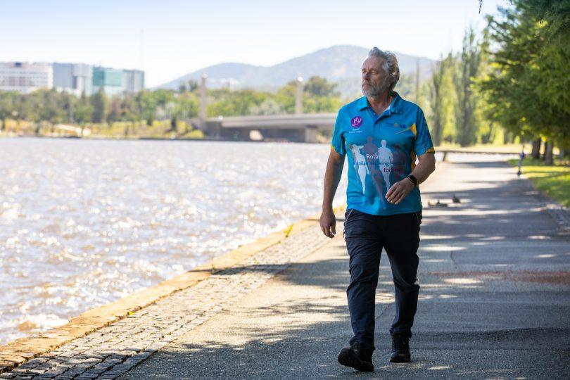 Chris Edwards walking along Lake Burley Griffin foreshore.