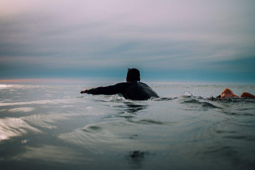 A surfer paddling