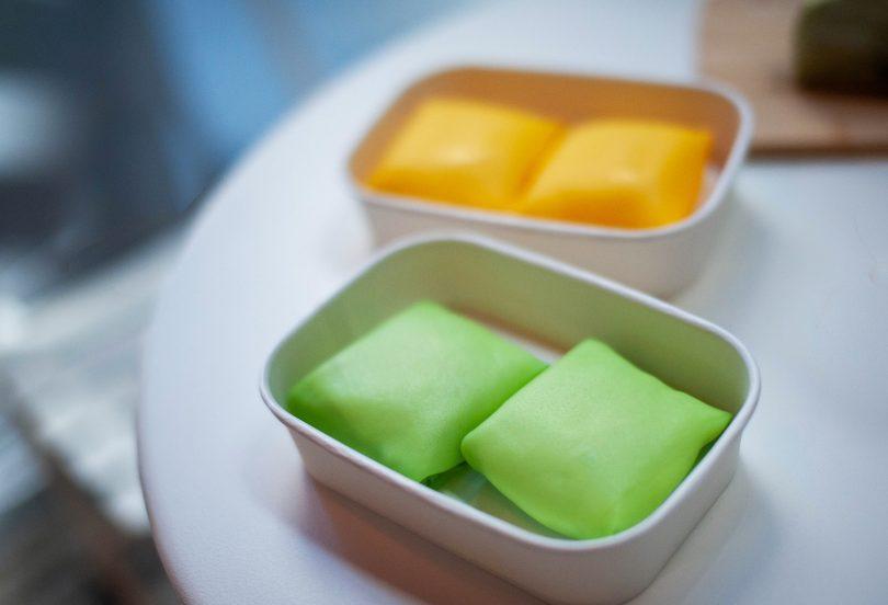 Bright green durian pancakes and sunset-hued mango pancakes