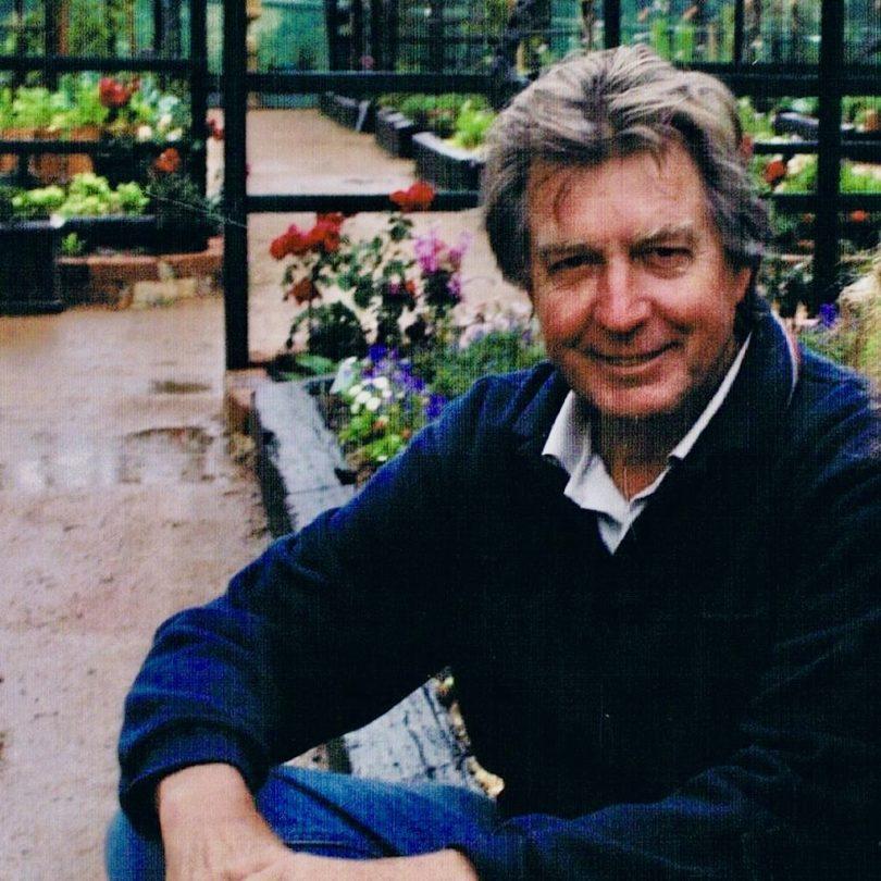 Doug Rawlinson sitting in garden.