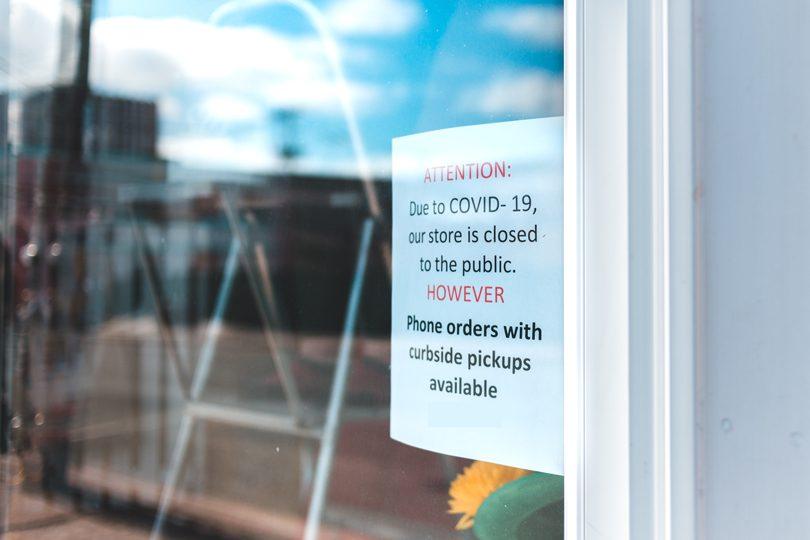 Sign on door of closed shop.