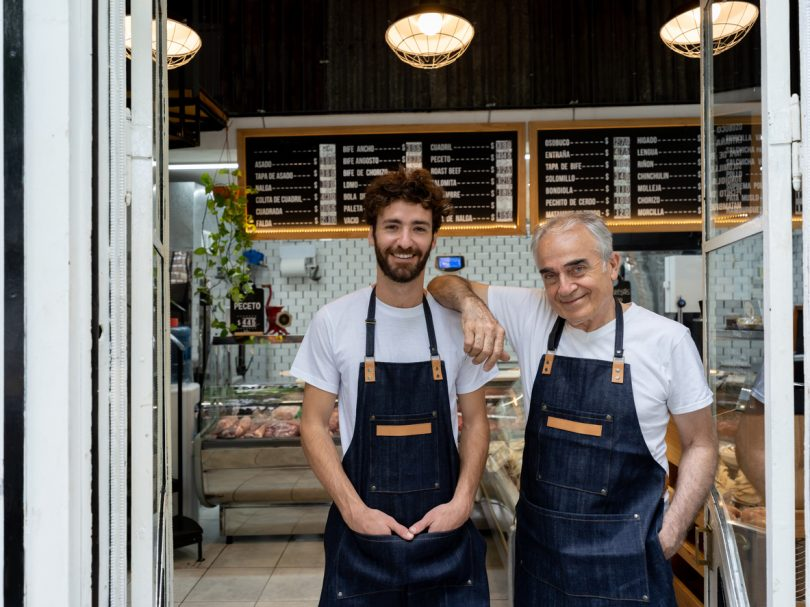 Father and son working at butchery