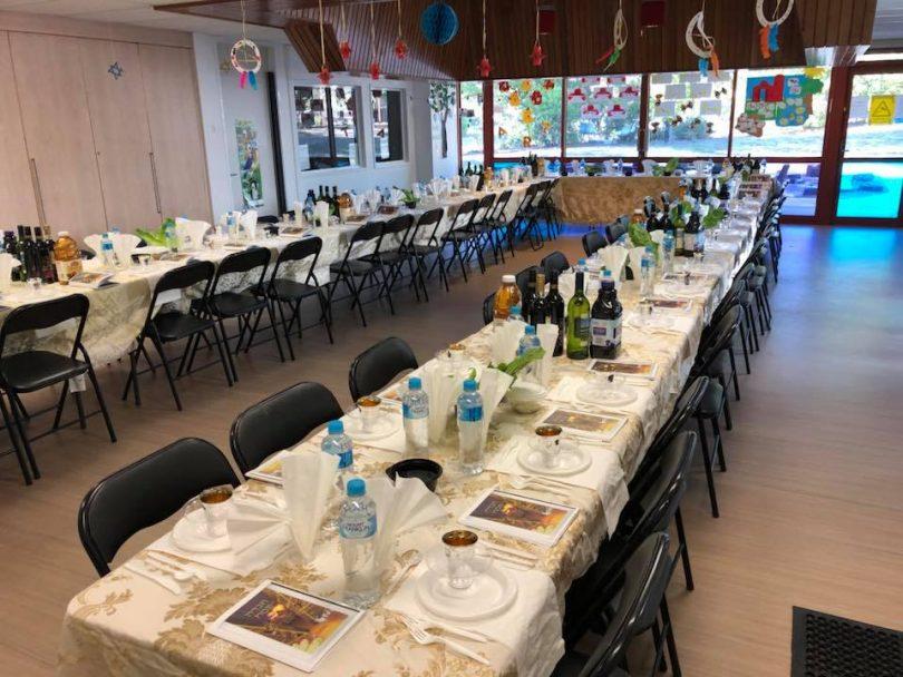 Long dining tables set at Chabad ACT.