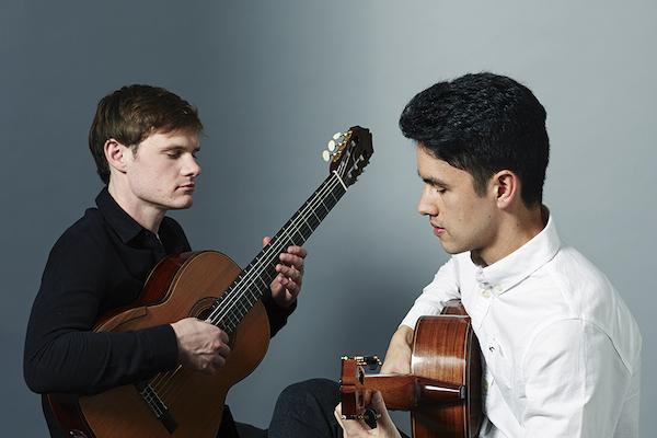 Andrew Blanch and Ariel Nurhadi playing guitars