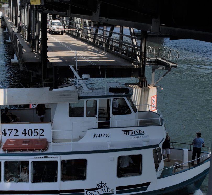 Boat passing under Batemans Bay Bridge.