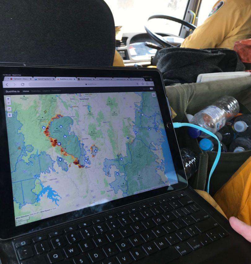 Bushfire.io website open on laptop in firetruck.
