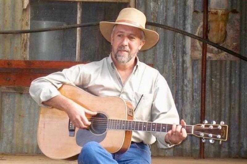 Ron McLaughlin playing guitar.