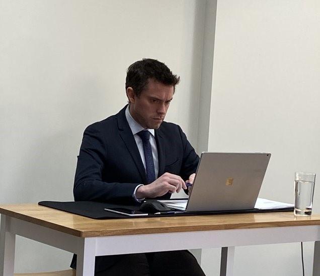 Tristan Morris working on laptop.