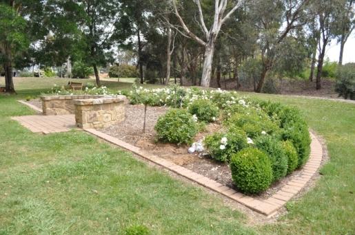Burial plot and rose garden at Gungahlin Cemetery.