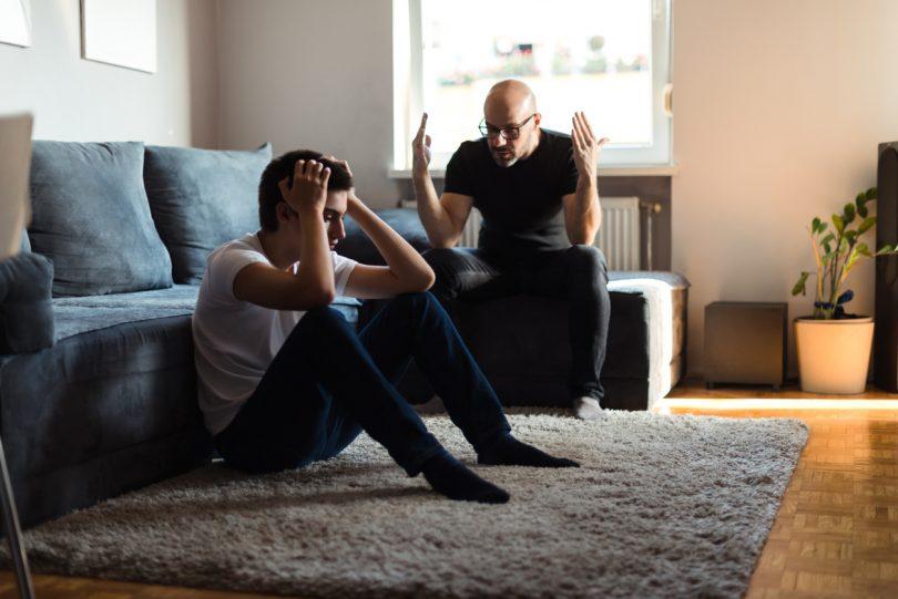 Dispute between two men in lounge room
