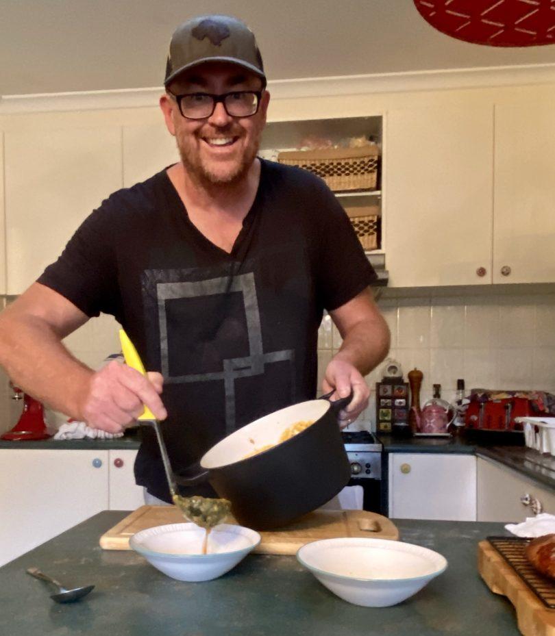 Joshua Brandt Rosner serving meal in kitchen at home.