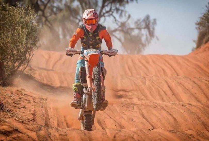 Michael Beard on motorbike in Finke Desert Race.