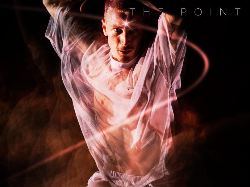 A dancer with light around him
