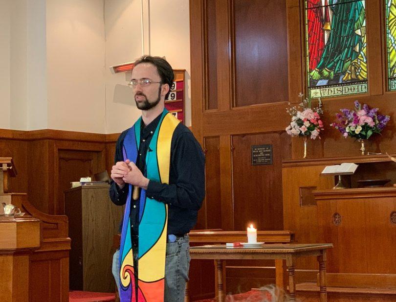 Minister Daniel Mossfield conducting church service