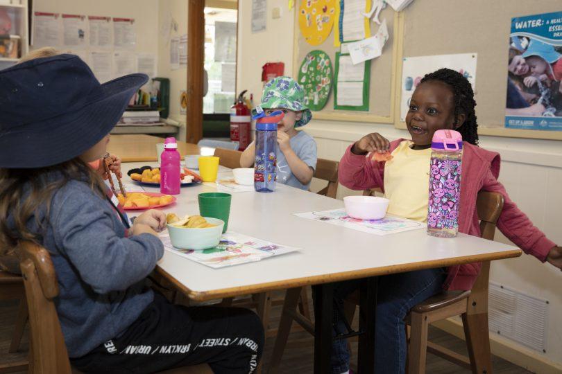 Students sitting at table at WCS Evatt Preschool